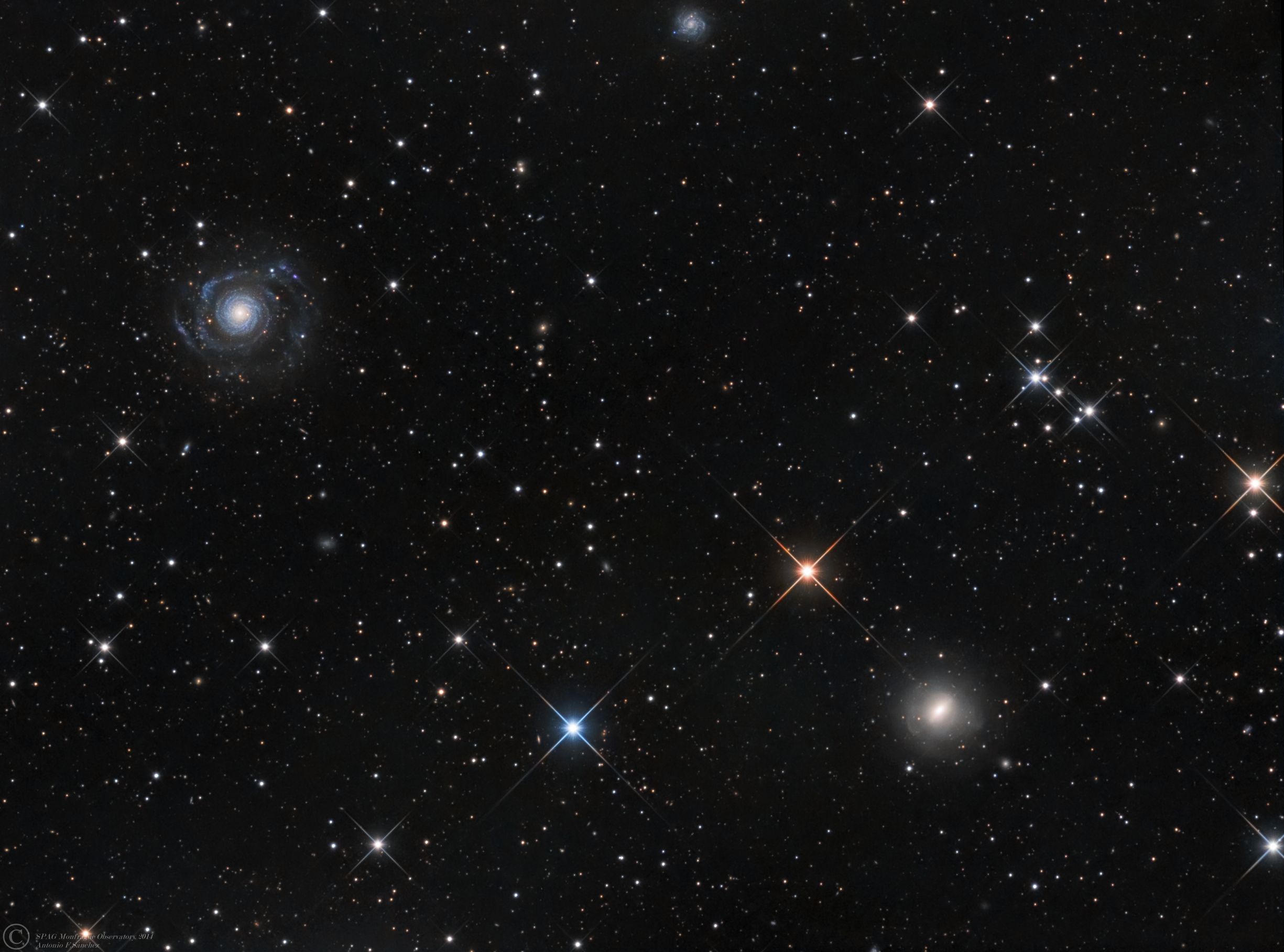 NGC 3642-3610 LRGB (Ursa Major).jpg - NGC 3642,NGC 3610, PGC 34666 ( Ursa Major) * February- March 2014 * ASA N12 astrograph ( f/3.6, 1078mm ) * ASA DDM85 mount * FLI Ml 8300 ar-25ºC * Optec LRGB filter set * L: 540m R: 190m G 160m B: 190m * Unguided *NGC 3642, a galaxy disturbed by a past interaction, while classified as type SBc it displays a warped outer ring undergoing star formation at 1.5 times the rate on the inner area. Distance is 79 Mly.Star formation in the warped outer parts might be linked to the fact that NGC 3642 is located in a rich environment, where its close neighbors show clear signs of merging. Our suggestion is that NGC 3642 has captured recently a low-mass, gas-rich dwarf, and star formation was triggered in this infalling external gas that produced also a pronounced warp in the gaseous disk.Verdes-Montenegro, L.; Bosma, A.; Athanassoula, E.NGC 3610 is a member of the NGC 3642 Group (LGG 234), with ?ve cataloged members. The NGC 3642 Group itself is a subgroup of the rich (N = 170) Group 94 of Geller.The optical peculiarities include two or three shells,a central X-structure, plumes, and extraordinarily boxy outer isophotes (Forbes & Thomson 1992; Whitmore et al(1997)The idea of this image was to show NGC 3610 not just as an elliptical galaxy, but show the shells all aorund it...¡¡Studies in this galaxy, suggest the presence of a small stellar edge-on disk imbedded into its spheroid.The disk modelling , allows to derive strong constraints on the inclination of the galaxy.Residuals image obtained form ths substraction of disk-model reveals the presence of an additional weak outer disk and a shell. Latter features suggest an interaction process in the more recent history of this galaxy. http://www.spacetelescope.org/images/opo9734r/http://www.cv.nrao.edu/~jhibbard/HIinEs/2003AJv125p667.pdfhttp://articles.adsabs.harvard.edu//full/1990A%26A...235...49S/0000049.000.html