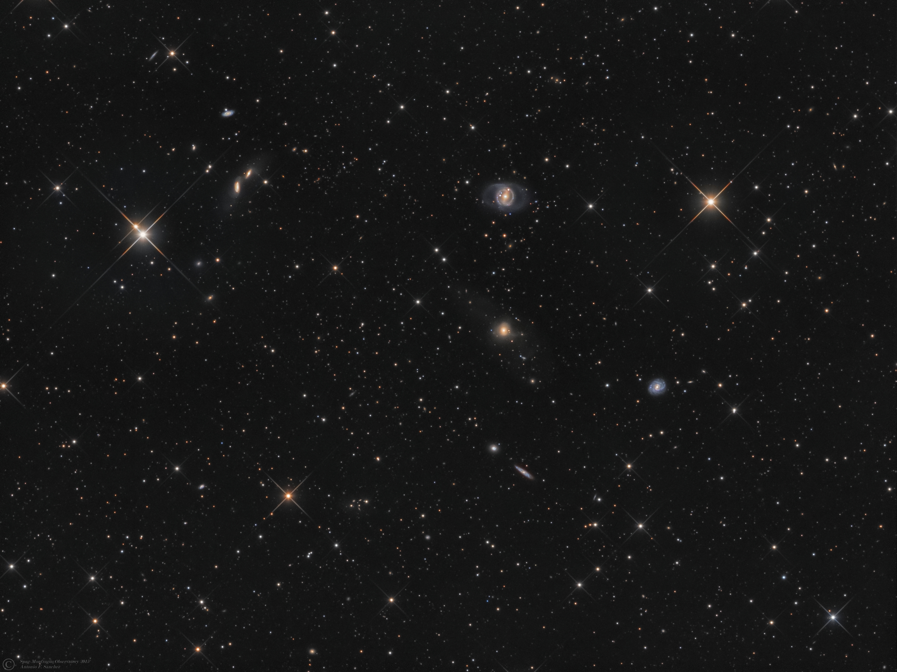 "NGC 5934,5935,5943,5945,5947 (Bootes).jpg - NGC 5934-5935,5943,5945,5947 (Bootes) * May 2015* ASA N12 astrograph (f/3.6, 1078mm) * DDM85 mount * FLI ML8300 *LRGB Optec filter set * L:720m R:240m G200m B:270m * Unguided *NGC 5945, along with the other galaxies in the image, are located in the constellation Boötes. NGC 5945 is an example of a barred galaxy,.spiral whose arms overlap making a pseudo ring. Besides these rings there are two outer arm segments that see to make huge ""ears"" on the east and west sides of the galaxy.  The two arms appear to have a high concentration of hot young blue stars. Just above the rings is a blue area, of possibly similar stars, that appear to have become slightly disconnected from the galaxy. To the far left, of NGC 5945, is a pair of interacting galaxies,NGC 5934 and 5935.Both have plumes drawn out of them by the interaction. Below the pair is KISSR 1955 a starburst galaxy with a faint outer halo. Starburst activity can be triggered by interaction with another galaxy but this isn't necessary.At the center of the image is the NGC 5943. This galaxy is very fuzzy with large plumes Closer examination reveals a jet coming from the right side of the galaxy. This jet may be related to the large, and faint, cloud that extends to the upper left and lower tight of NGC 5943.NGC 5947 is a rather pretty face on barred spiral with many arm segments.All are likely members of the same local group about a quarter billion light-years distant by redshift measurement. Hundreds of tiny galaxies and galaxy groups are here and there ,in the background,all around the image., some of them 3500 light years and even more...Text Credits: Bob Franke, Rick Johnson,Antonio F.Sánchez"