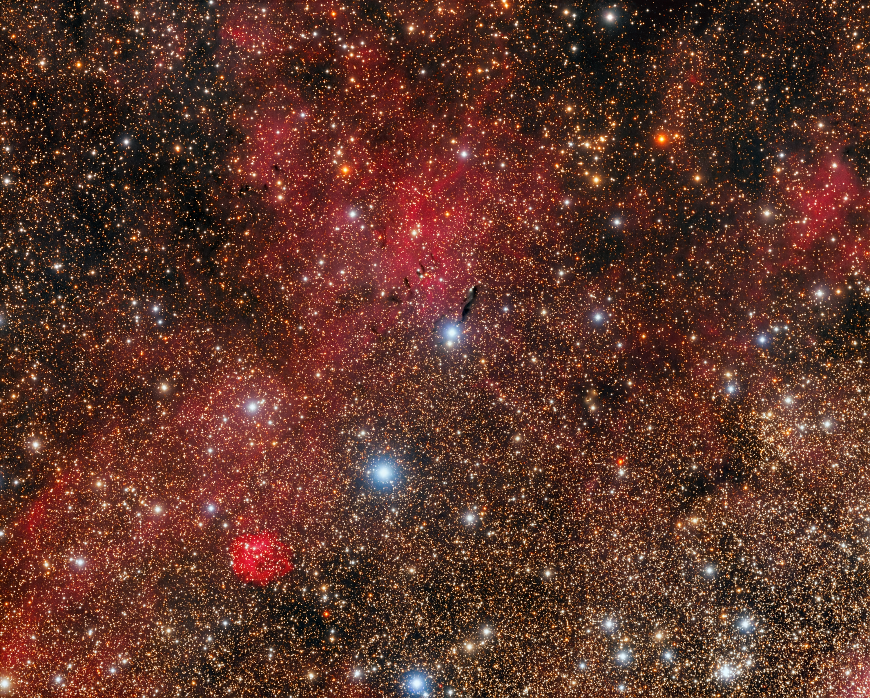 SH2 104,LBN 195,DWB 18, GM 1-27 (Cygnus).jpg - SH2-104,LBN 195,DWB 18,GM 1-27 (Cygnus)* June-July 2019 * Telescope CFF 135 (f/6.7 , 930mm) * ASA DDM85 mount * Moravian G3 16200 EC CCD* Baader LRGB filter set * L: 455 minutes R: 574 min G: 504min  B: 566 min *  Subframes unguided and acquired Autoslew & Sequence*Sharpless 104 (LBN 195, DWB 18) is a bright, circular emission nebula approximately 13,000 light-years away in Cygnus. The stars 'in' the nebula are cataloged as open cluster Dolidze 4.  The Sh2104 region is a good illustration of the `collect and collapse' model for star formation triggered by the expansion of an H II region.In the center of image , the nebulous object GM 1-27 on the basis of direct photographs and spectra obtained with the 6-m telescope shows that it is a cometary nebula with mixed (C + E) spectrum. The high negative radial velocities of the lines (/minus/150 to /minus/200 km/sec) indicate a directed outflow of matter from the central star (which is not directly observable).DWB 18 is an emission nebula located about in the center of the great dark rift that goes down much of Cygnus.Thanks to Mr. Sakib Rasool for suggesting this image.Credits : Astrophysics 28(3):356-359 · May 1988 (Tigran Yu.Magakian)Antonio F. Sanchez.